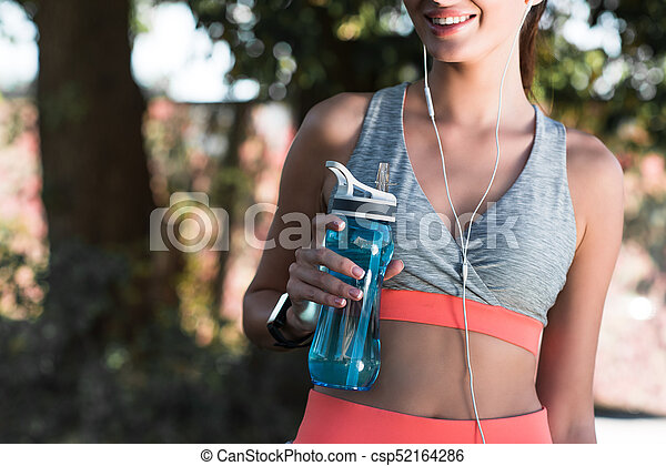 sporty girl drinking water - csp52164286