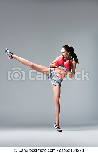 sporty girl in boxing gloves - csp52164278