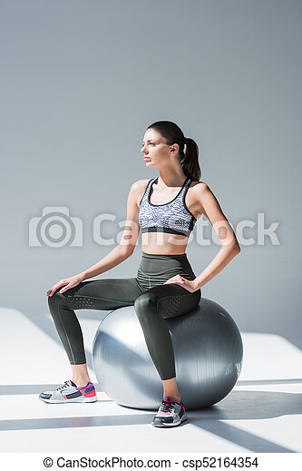 sporty girl with fitness ball - csp52164354