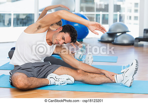 sporty people stretching hands at yoga class two sporty