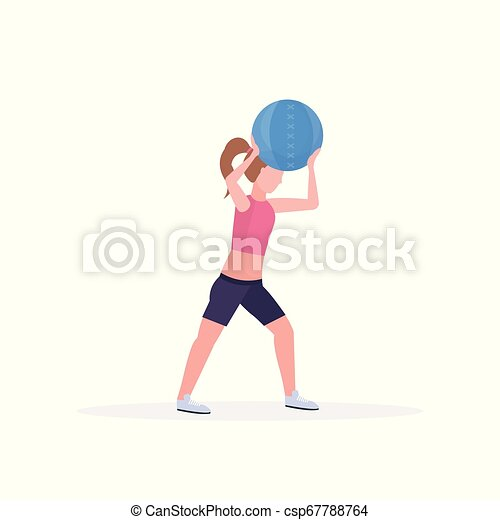 sporty woman doing crossfit exercises with medicine