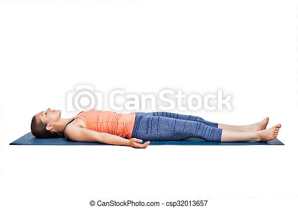 sporty woman relaxes in yoga asana savasana beautiful