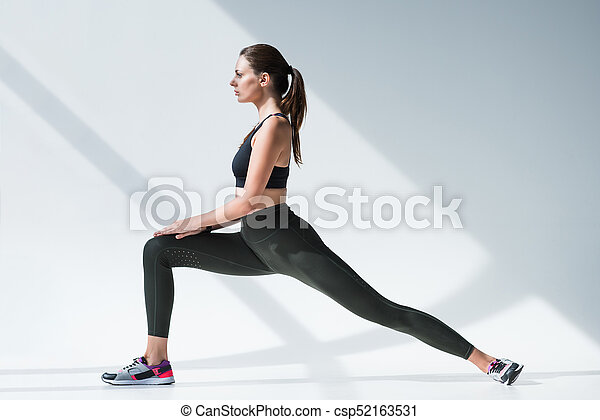 sporty woman stretching legs - csp52163531