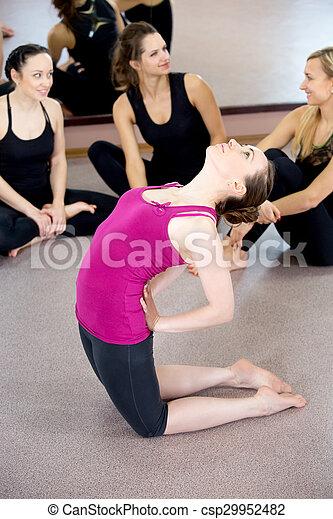 sporty yogi girl doing yoga camel pose bends backwards in