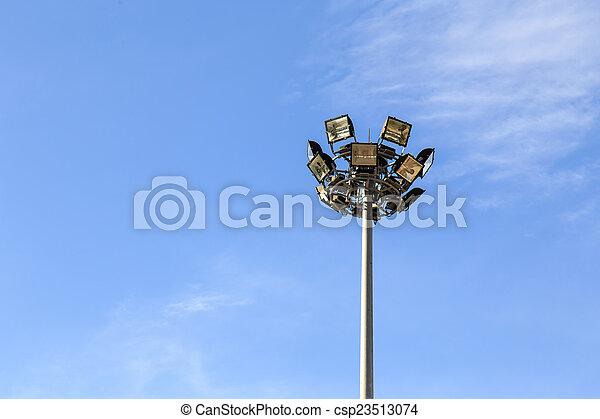 Spot light pole with blue sky in the stadium - csp23513074