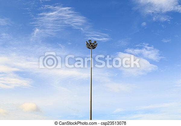 Spot light pole with blue sky in the stadium - csp23513078