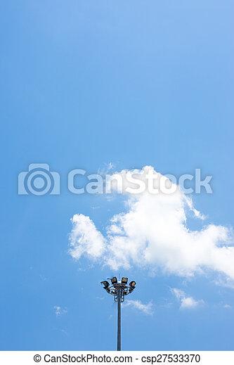 Spot light pole with blue sky in the stadium - csp27533370