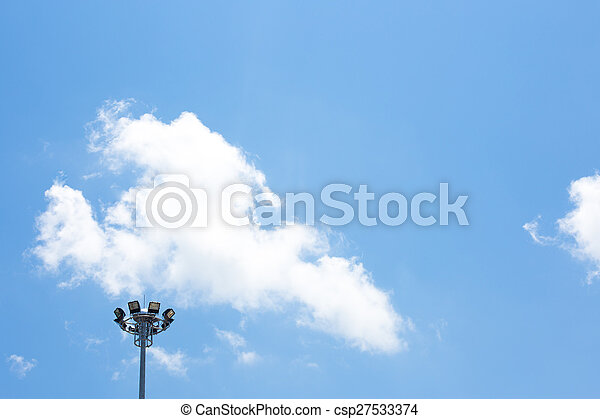 Spot light pole with blue sky in the stadium - csp27533374