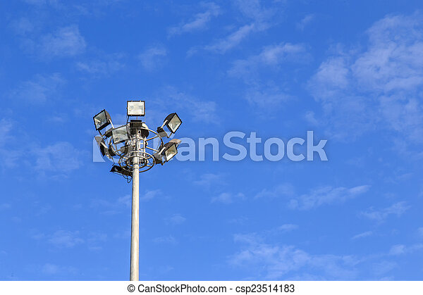 Spot light pole with blue sky in the park - csp23514183