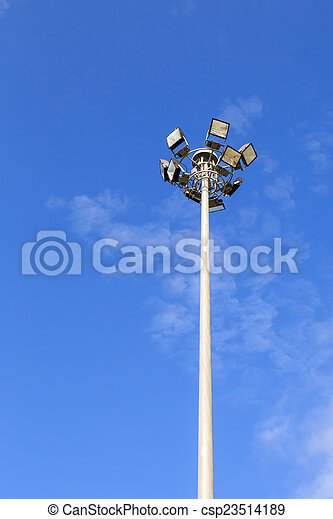 Spot light pole with blue sky in the park - csp23514189