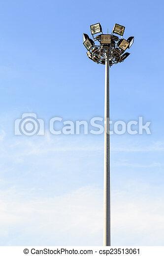 Spot light pole with blue sky in the stadium - csp23513061