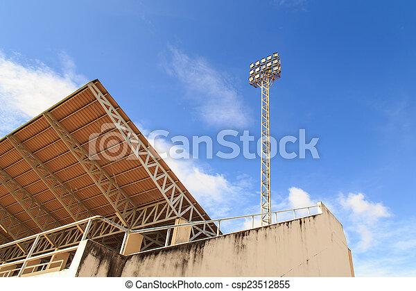 Spot light pole with blue sky in the stadium - csp23512855