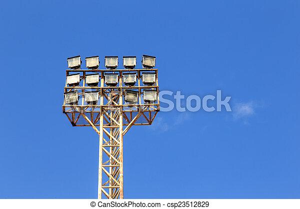 Spot light pole with blue sky in the stadium - csp23512829