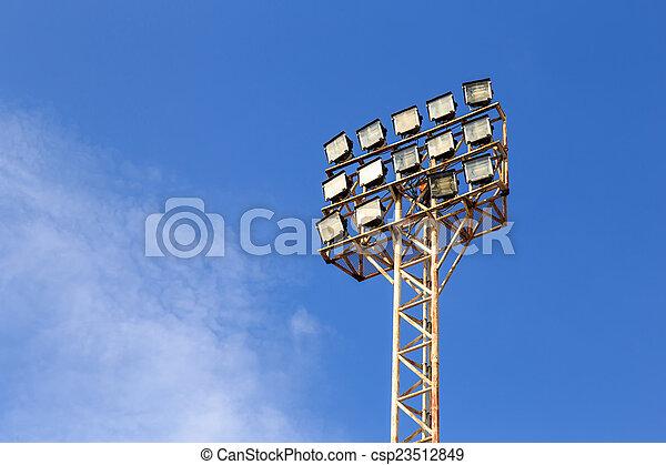Spot light pole with blue sky in the stadium - csp23512849