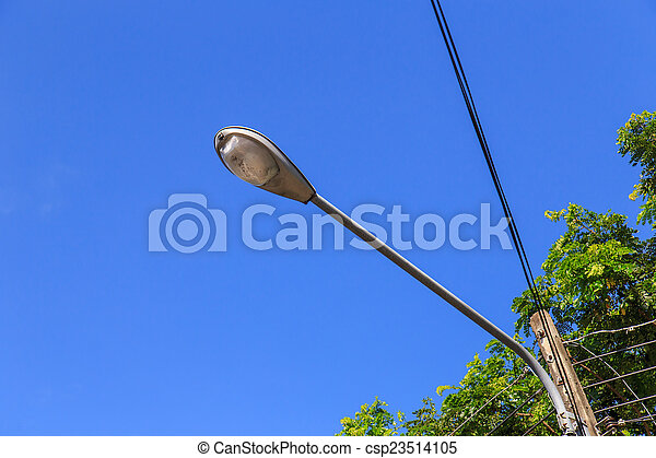 Spot light pole with blue sky in the park - csp23514105