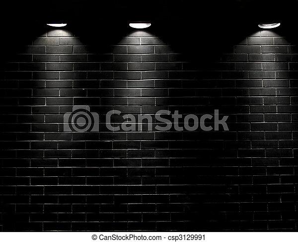 Spotlights On A Black Brick Wall Stock Photo