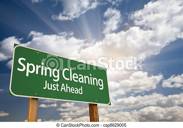 Spring Cleaning Just Ahead Green Road Sign and Clouds - csp8629005