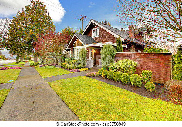Spring exterior house with brown siding - csp5750843