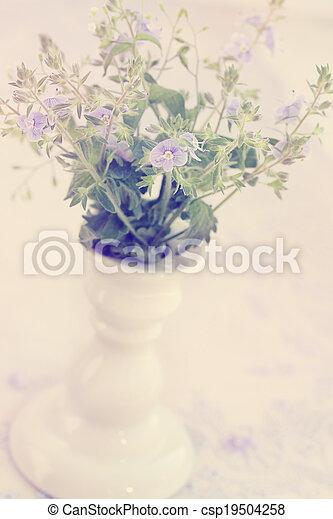 spring flower in a vase, vintage - csp19504258