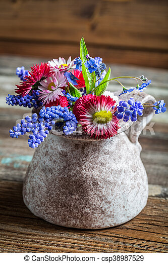 Spring flowers in a vase - csp38987529