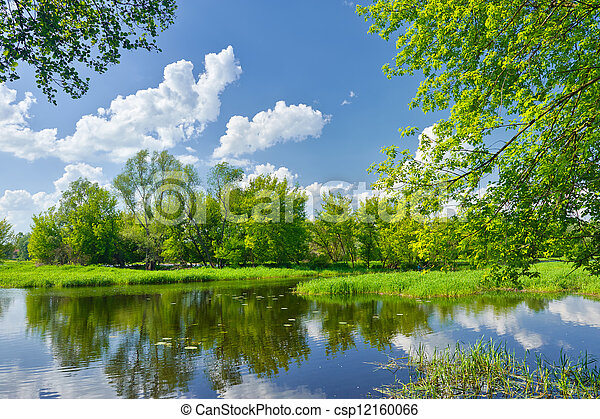 Spring landscape with Narew river and clouds on the blue sky - csp12160066