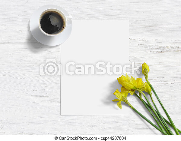 Spring styled stock photo feminine mock up with daffodil flowers spring styled stock photo feminine mock up with daffodil flowers narcissus list of paper and cup of coffee shabby white background mightylinksfo