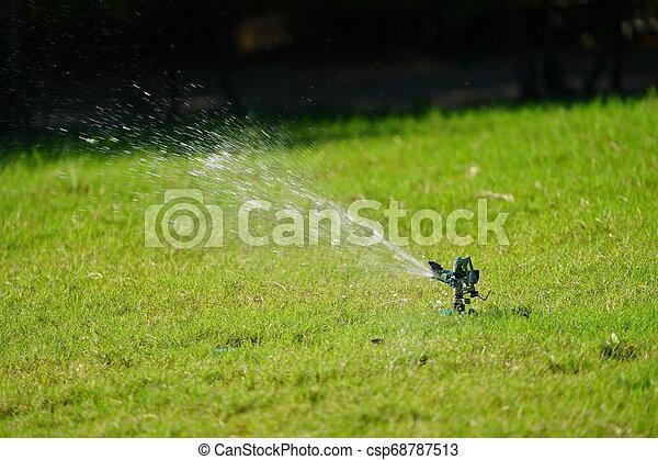 Sprinkler grass working system, working on the field in the garden. - csp68787513