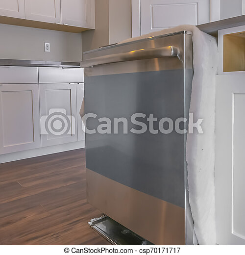 Square Close up of a dishwasher on a kitchen island against brown wooden  floor