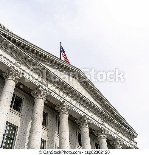 Square crop Pedimented entrance of historic Utah State Capital building in Salt Lake City - csp82302120