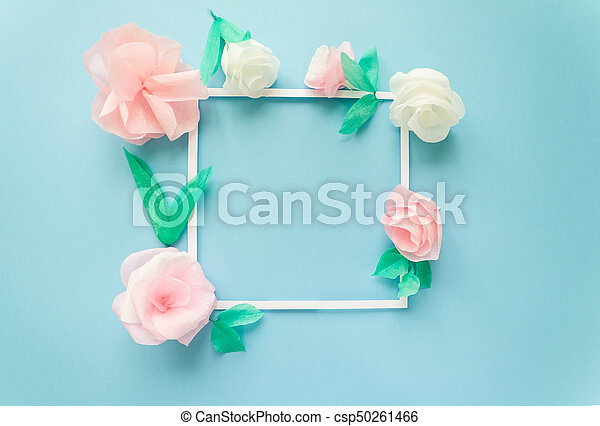 Square frame with color paper flowers on the blue background flat square frame with color paper flowers on the blue background flat lay nature concept cut from paper place for your text mightylinksfo