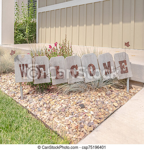 Square Welcome sign in front garden of traditional home - csp75196401