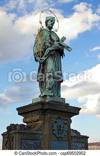 St. John of Nepomuk, Charles bridge, Prague, Czech republic - csp69502952