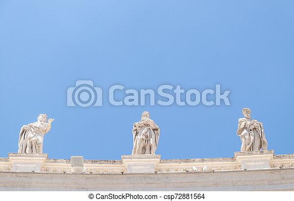St. Peter's Square colonnades' sculptures - csp72881564