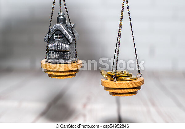Stack of coins and a small house on the scales. The concept of choice, cash savings and purchase of real estate. - csp54952846