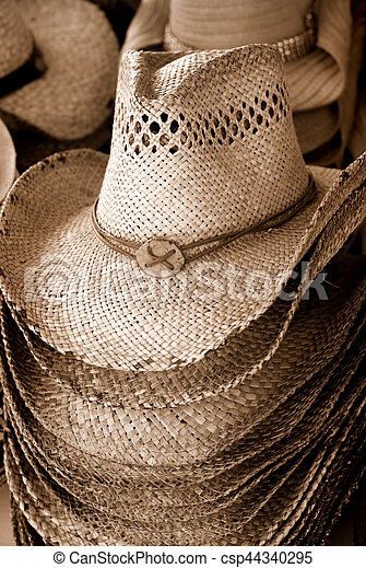 b546c37e9124ca Stack of cowboy hats in sepia for sale - csp44340295