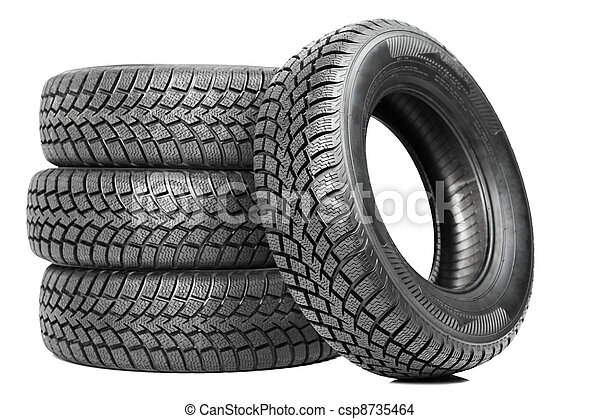 Stack of four car wheel winter tires isolated - csp8735464