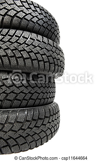 Stack of four car wheel winter tyres isolated - csp11644664