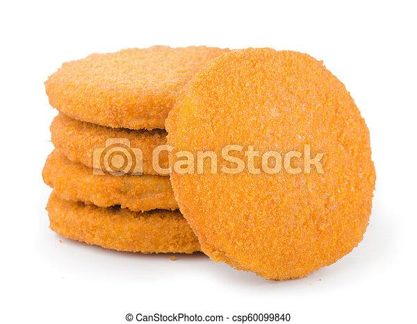 Stack of frozen breaded fish patties - csp60099840
