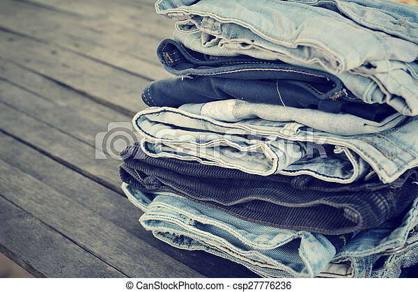 Stack of jeans - csp27776236