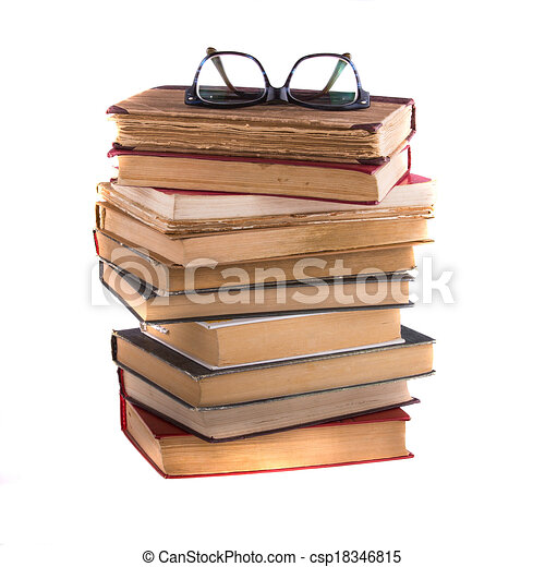Stack of old antique books and spectacles, isolated on white background. - csp18346815