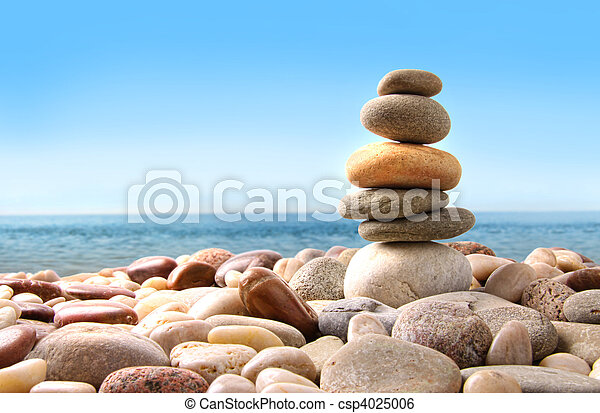 Stack of pebble stones on white - csp4025006