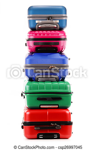 Stack of plastic suitcases isolated on white - csp26997045