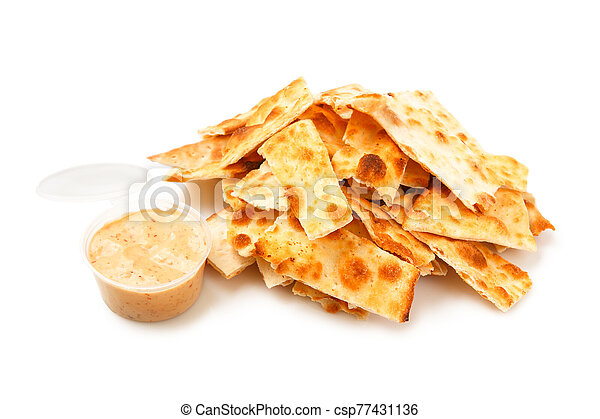 Stack of salted crackers isolated on white background. - csp77431136