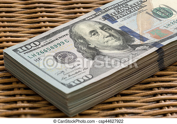 Stack Of Usd 100 Dollars Bills On Wicker Background Stack Of