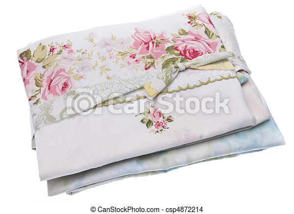 Stack of vintage fabric isolated on white with a clipping path. - csp4872214