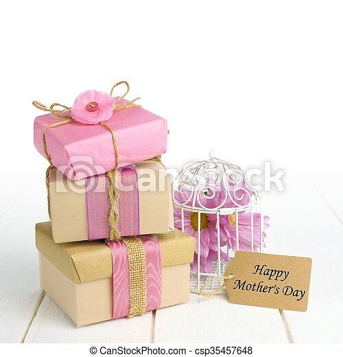 Stacked gift boxes with Happy Mothers Day tag and bird cage - csp35457648