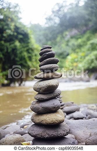 Stacked Zen Stones At Tegenungan Waterfall At Bali Indonesia