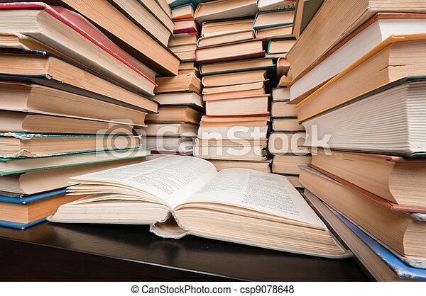 stacks of books on black table big stacks of hardcovered books