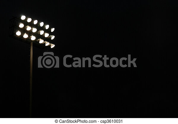 Stadium lights on a sports field at night with copy space - csp3610031