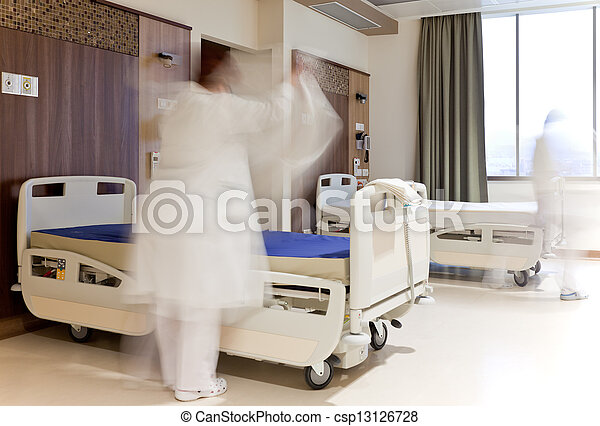 staff fixing bed hospital room - csp13126728